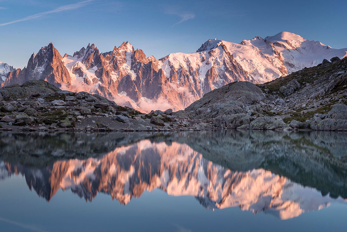 Mirror image of the Mont Blanc range in an alpine lake